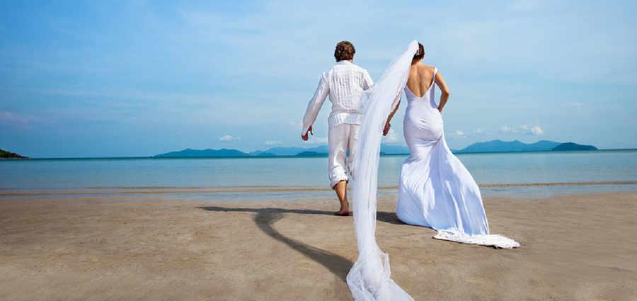 Couple on beach at wedding destination